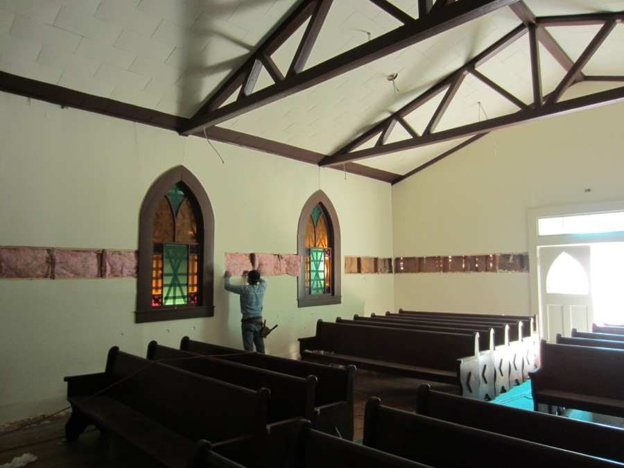 Installing new wiring and insulation in the sanctuary.
